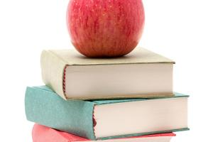 image of apple on stack of books